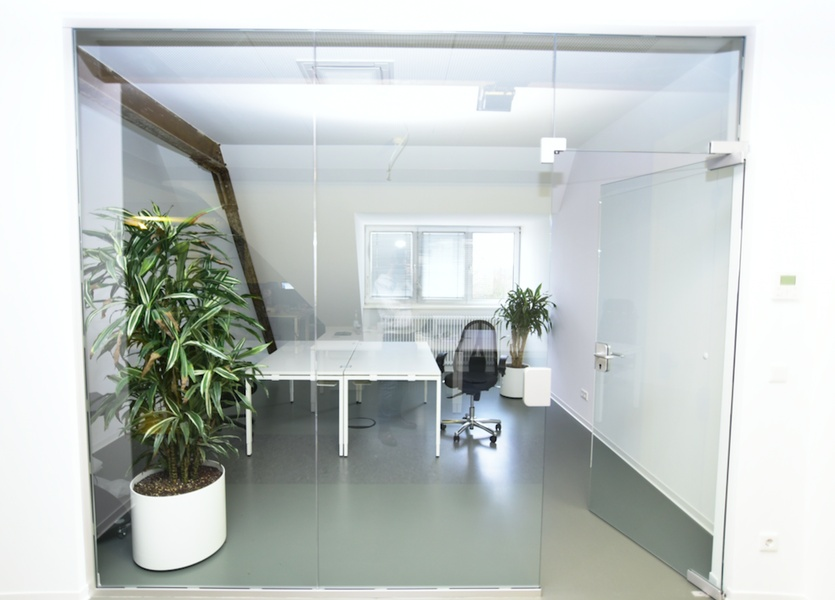 ** Modern top-floor room / coworking space **