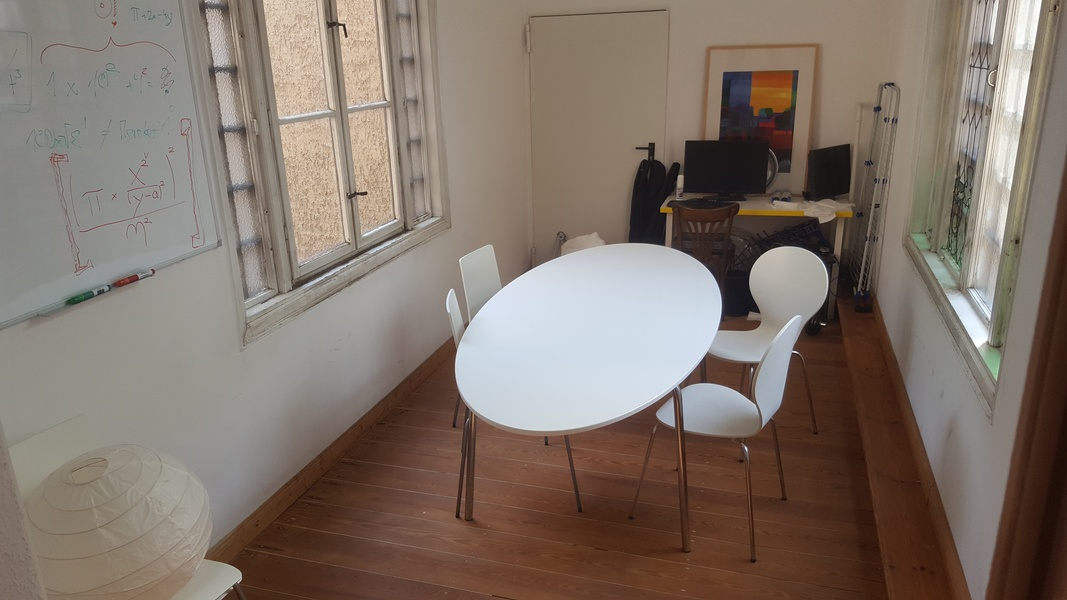 Furnished room in bigger office space (8 desks)