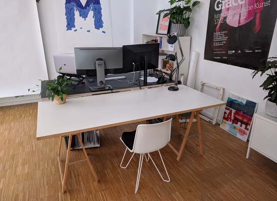 Large desk in a creative studio in Wedding